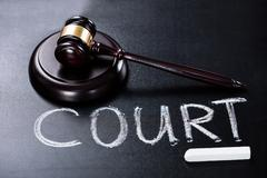 Court Concept With Gavel On Blackboard Stock Photos