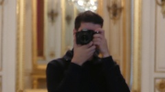 A Man Taking a Photo Inside of a European Museum Stock Footage