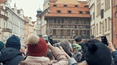 Tourists watch on the famous astronomical clock on the town hall in Prague Stock Footage
