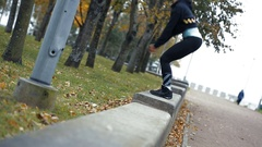 Woman outdoor at park doing fitness exercise jumps Stock Footage