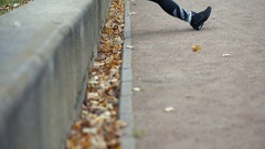 Portrait of woman in sportswear, doing fitness push-ups exercise at fall park Stock Footage