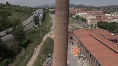 Aerial ascending industrial chimney Terrassa drone Stock Footage