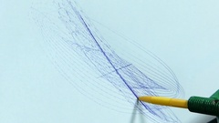 A Robot`s Hand Drawing a Line on a Sheet of Paper Stock Footage