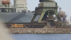 Men working under the harbor cranes Stock Footage