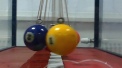 Swinging Plastic Colored Balls on Steel Ropes. Stock Footage