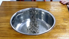 A Pyramid of Paper Clips Falling in Kitchen Sink. Stock Footage