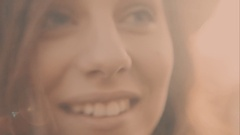 Close-up portrait of a beautiful young girl with long dark hair wearing straw Stock Footage