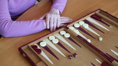 Closeup of older woman playing backgammon Stock Footage