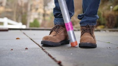 Slow Motion Man Dropping Lead Pipe on Toes Stock Footage