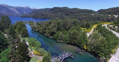Aerial scene, river and lake, yellow plants, traffic appears over the bridge Stock Footage