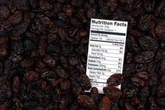 Nutrition facts of organic raisins Stock Photos