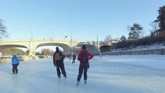 Ottawa Rideau Canal skating couple go under bank street bridge 4k Stock Footage