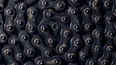 Close up top view of rusty dirty metal bicycle chain in circle shape rotating Stock Footage