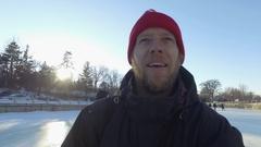 Ottawa Rideau Canal happy bearded guy skates under bank street bridge selfie 4k Stock Footage