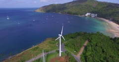 Aerial: Flying around the windmill. Promthep cape. Naiharn and Yanui beach. Stock Footage