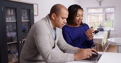 4K Cheerful couple shopping online at home & entering credit card details Stock Footage