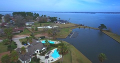 Aerial Footage - Flying Across The Edge of Diamond Head On Lake Conroe Stock Footage