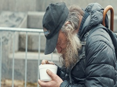 Poor homeless beard eating soup plastic plates Stock Footage