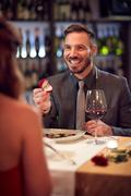 Man engaged woman in restaurant Stock Photos