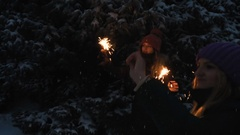 Two Happy beautiful Teen Girls having fun with sparklers in winter holidays. Stock Footage