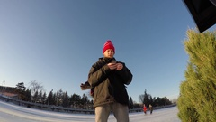 Ottawa Rideau Canal man checks his cellphone while on ice 4k go pro Stock Footage