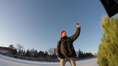 Ottawa Rideau Canal ice skating happy bearded guy phone selfie then skates away Stock Footage