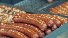 Barbecue large grill outdoors. Cookout bbq food. Big roasted pork bratwurst Stock Footage