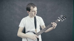 Young man plays the banjo. Black background Stock Footage