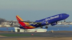 Southwest Airlines plane taking off airport runway, slow motion Stock Footage