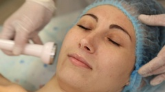 Facial massage using specialized equipment Stock Footage