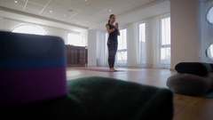 Yoga trainer executing a sequence Stock Footage