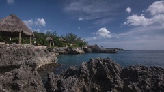 Jamaica: Rocky Coast with Thatch Hut, Day and Sunset Stock Footage