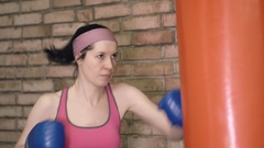 Boxing training woman with punching bag Stock Footage