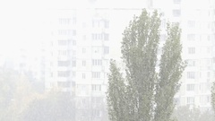 Blizzard With Snowflakes Falling Heavily With a Multi-Storey Building in the Stock Footage