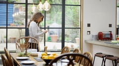 4K Happy couple in the kitchen at home, chatting while man prepares a meal Stock Footage