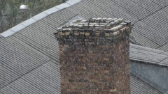Old Red Brick Chimney on a Slate Roof Being Covered With Heavy Snow Stock Footage