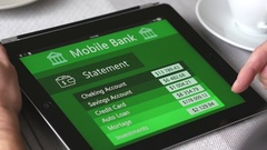 4K Mobile Banking Statement on Tablet Screen at a table Stock Footage