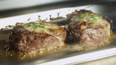 Meat fillets in butter baked in oven. Slow motion Stock Footage