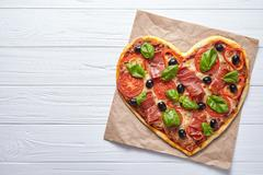 Pizza heart shaped love design concept Valentine's Day symbol romantic dinner Stock Photos