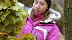Girl Makes Wreath of Yellow Maple Leaves. Stock Footage
