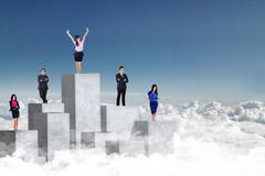 Entrepreneurs standing on concrete wall Stock Photos