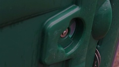 Outhouse door switch turns from open to locked Stock Footage