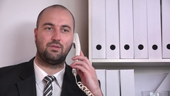 Portrait of successful business man discussing on landline head close up view  Stock Footage
