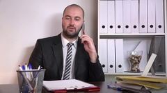 Serious trustworthy business man office interior working mobile phone call chat Stock Footage
