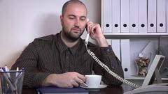 Entrepreneur businessperson drinking coffee talking landline phone communication Stock Footage