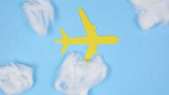 4K Stop Motion Animation Plane Flying Under Clouds Stock Footage