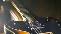 A man takes an electric guitar Stock Footage