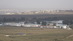 Destructed Syrian buildings behind United Nations camp at border with Israel Stock Footage