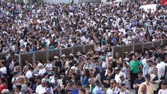 Massive diverse crowds visit square at Western Wall, Jerusalem Israel Stock Footage
