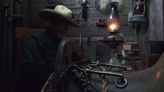 Cowboy Western, Man loading old shotgun in bunkhouse, Stock Footage